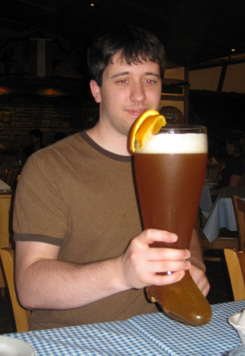 Matt Poulter drinks from das boot.